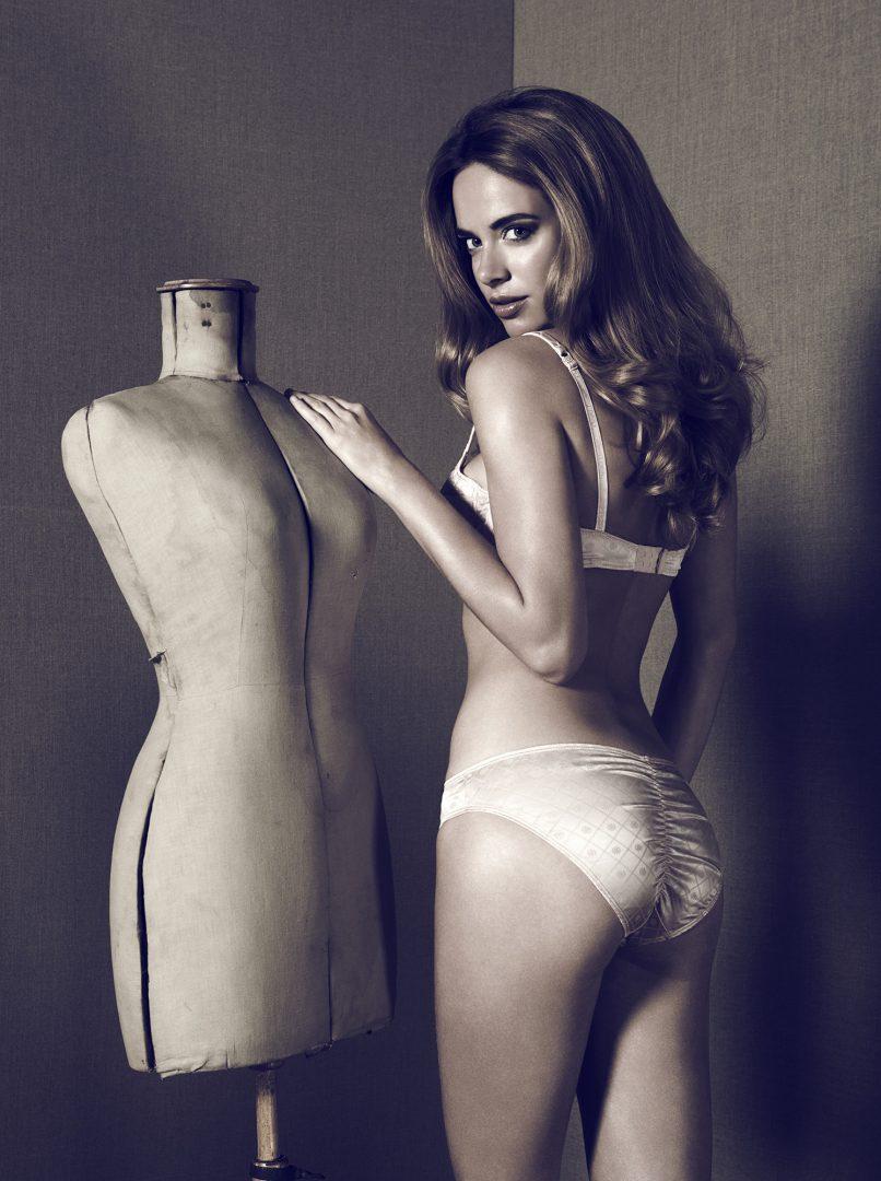 Girl in lingerie in middle of stockman by Stefan Rappo
