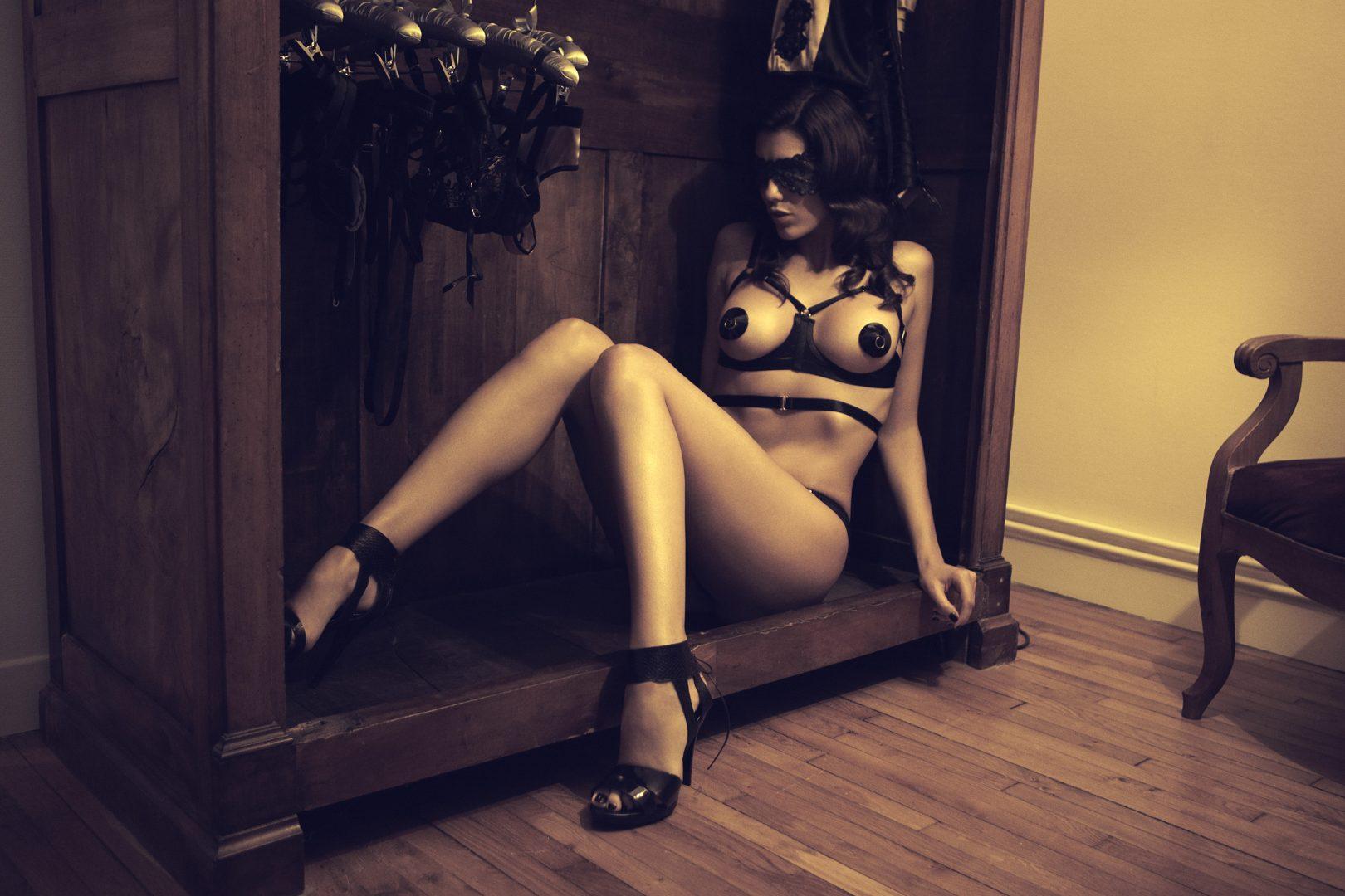 Girl on lingerie sitting in a closet by Stefan Rappo