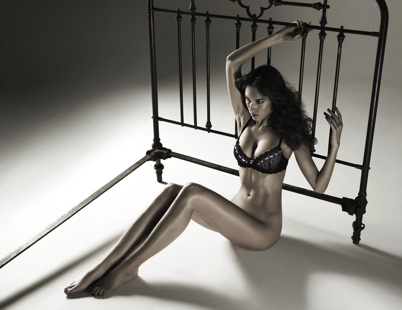 Girl in lingerie sitting on floor by Stefan Rappo