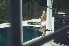 Thumbnail girl walking by pool in swimsuit by Stefan Rappo