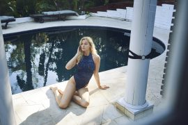 Thumbnail Girl sitting on floor in swimsuit by Stefan Rappo