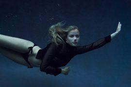 Thumbnail Girl diving in pool in swimsuit by Stefan Rappo