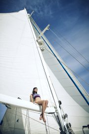 Thumbnail girl sitting on boat by stefan rappo