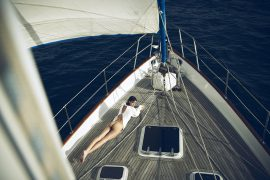 Thumbnail girl lying on boat by stefan rappo
