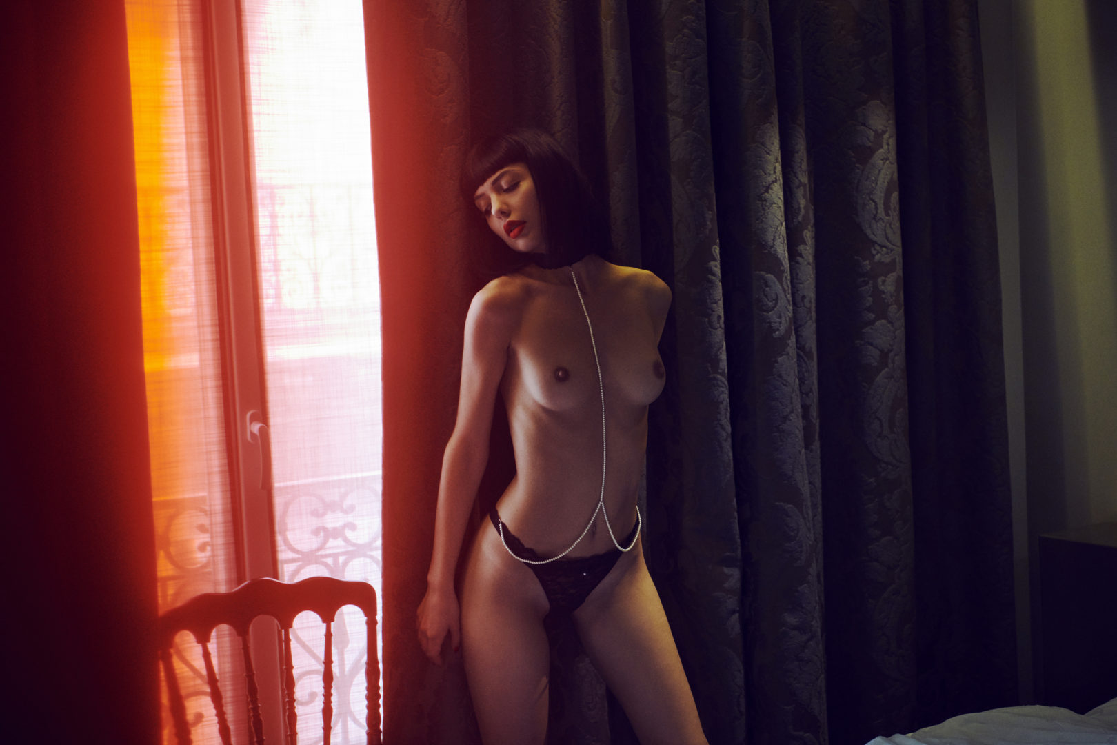 girl in lingerie in hotel room