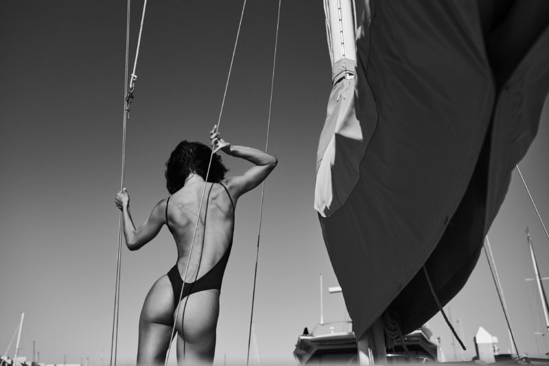 girl on boat in swimwear shot by stefan rappo