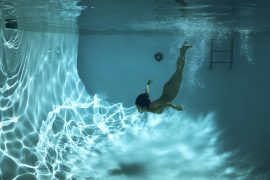 Thumbnail Naked girl diving in swimming pool by Stefan Rappo