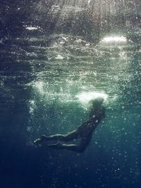 Thumbnail Naked girl emerge in sea by Stefan Rappo