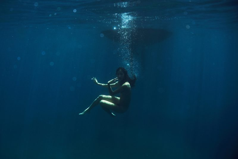 Naked girl under water in sea by Stefan Rappo