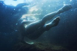 Thumbnail Naked girl under water in sea by Stefan Rappo