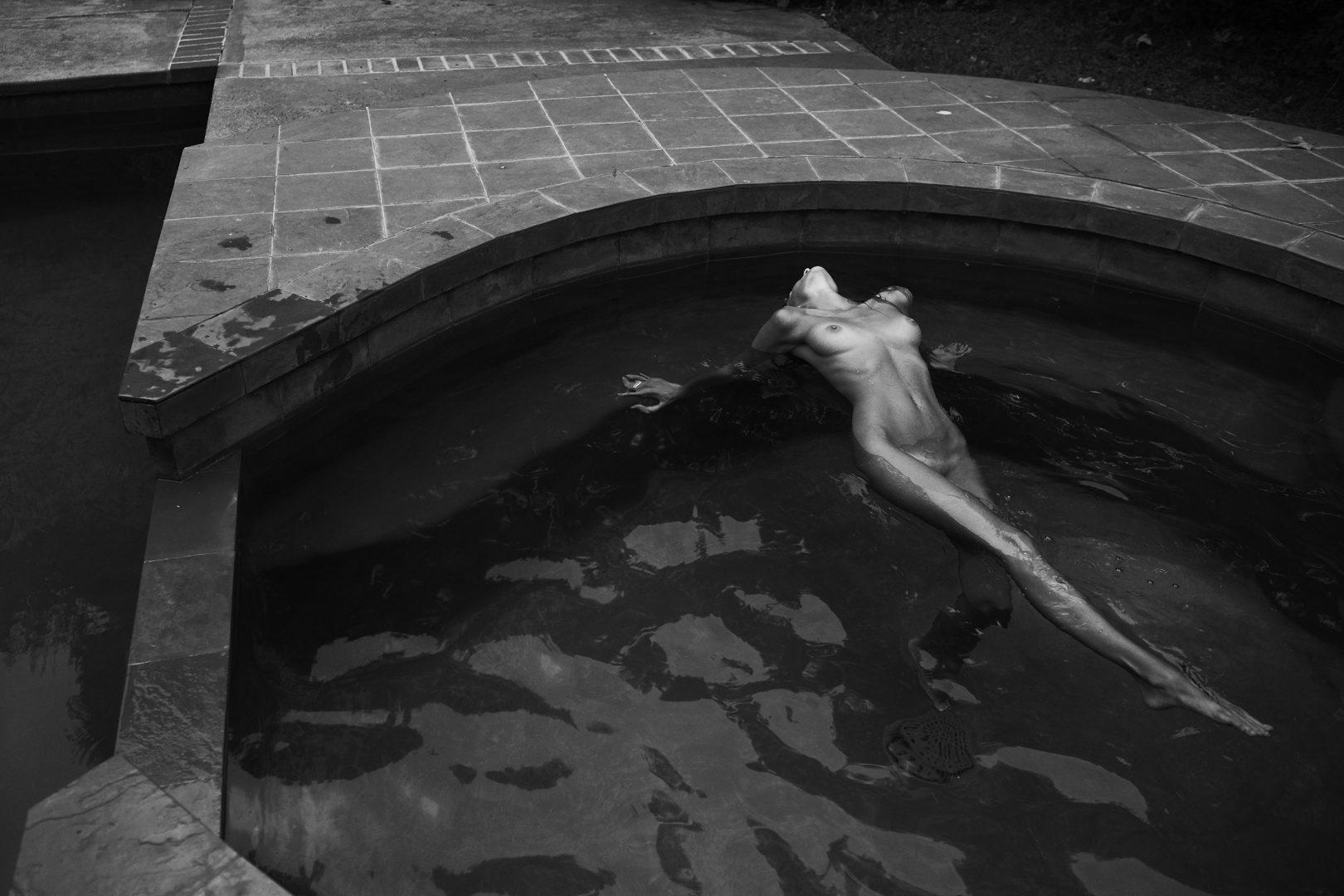 Naked girl poolside by stefan rappo
