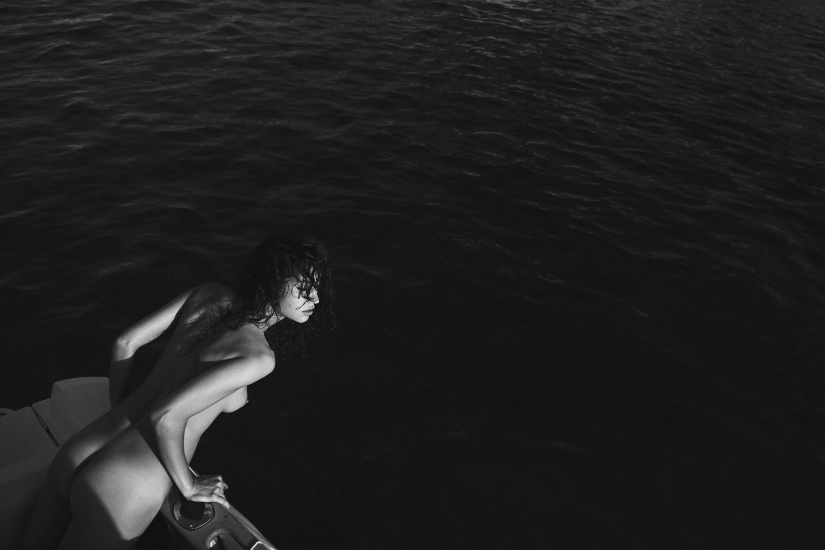 Naked woman on boat by stefan rappo