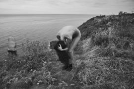 Thumbnail naked girl on cliff by stefan rappo