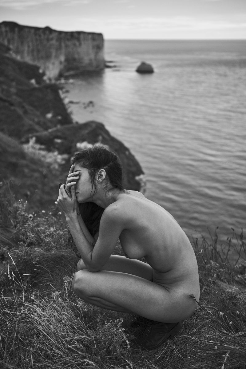 naked girl on cliff by stefan rappo