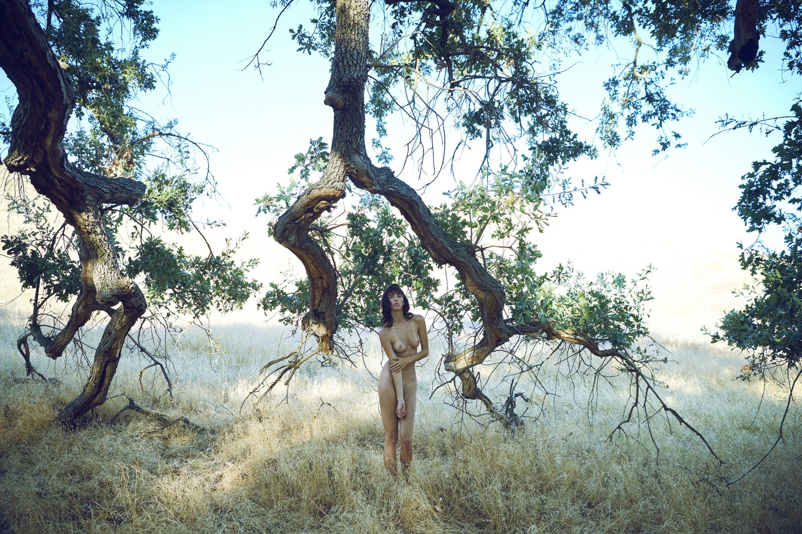 Naked girl standing in front of tree by stefan rappo
