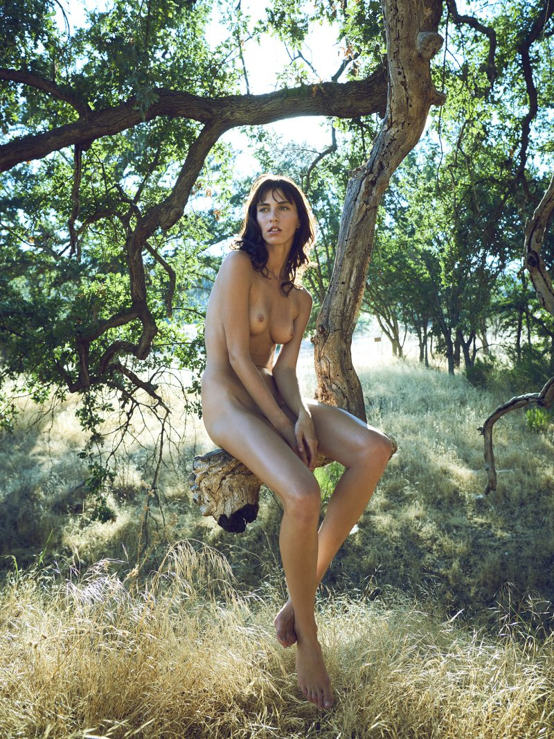Naked girl sitting on tree by stefan rappo