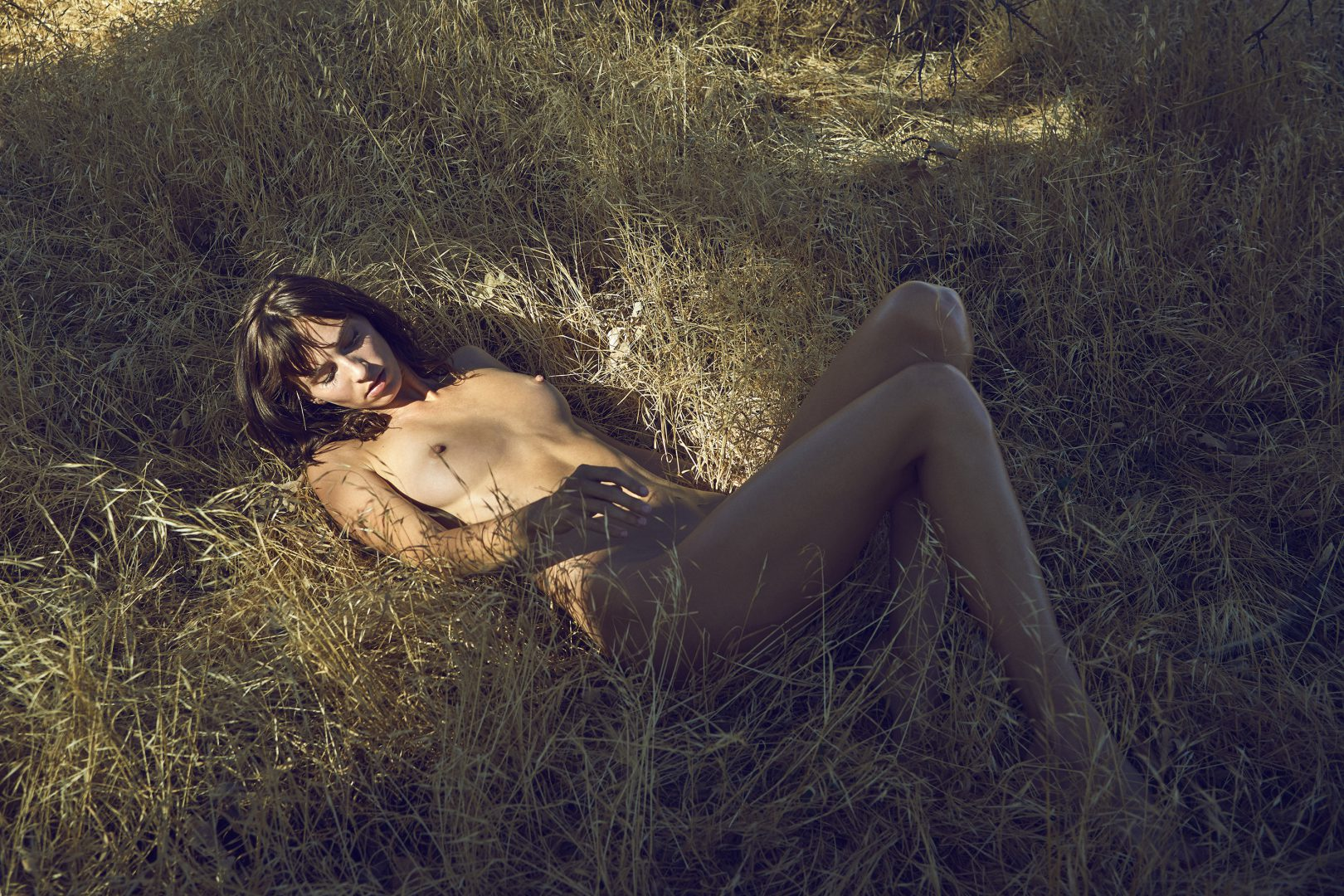 Naked girl lying outside on floor by stefan rappo