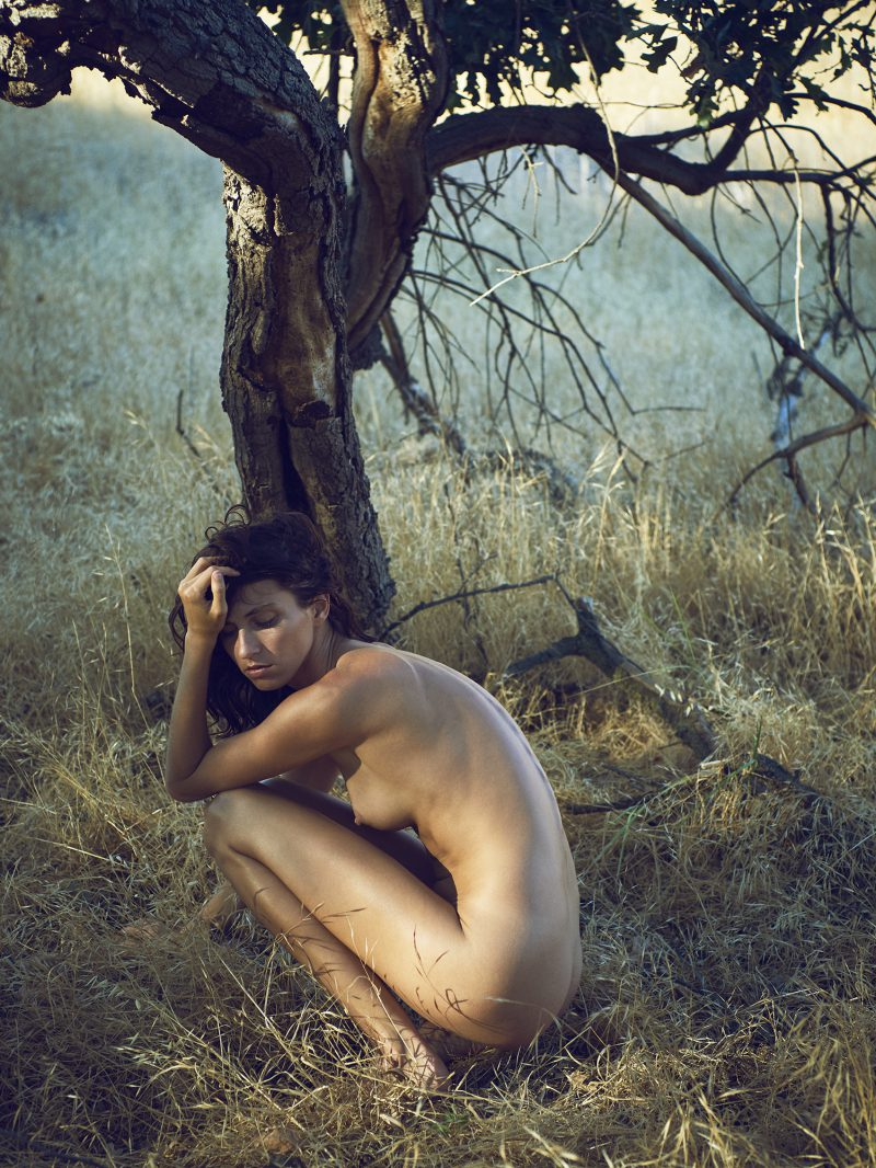 Naked girl sitting in front of tree by stefan rappo