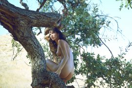 Thumbnail Naked girl sitting on tree by stefan rappo