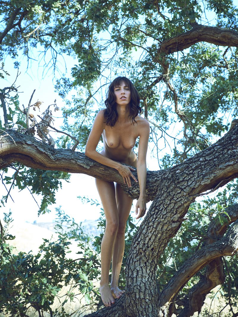 Naked girl standing on tree by stefan rappo