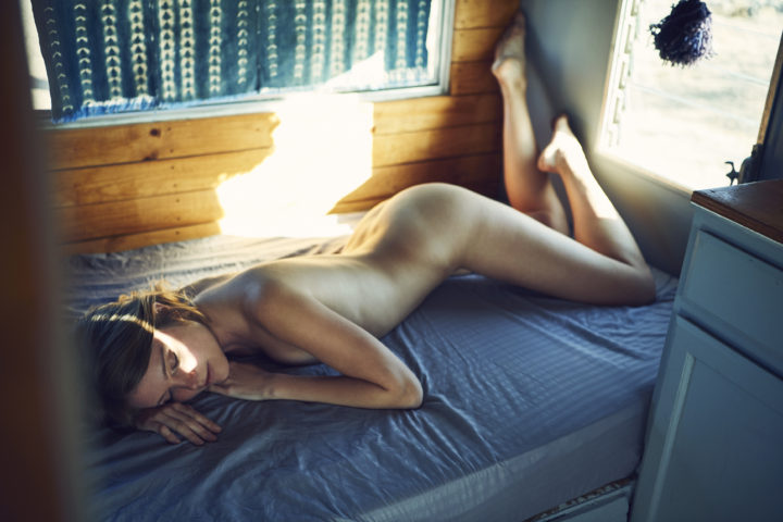 girl laying naked in trailer