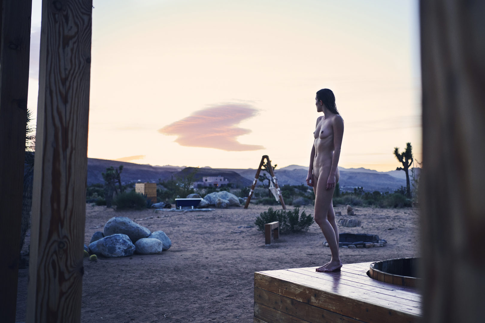 naked girl watching sunset