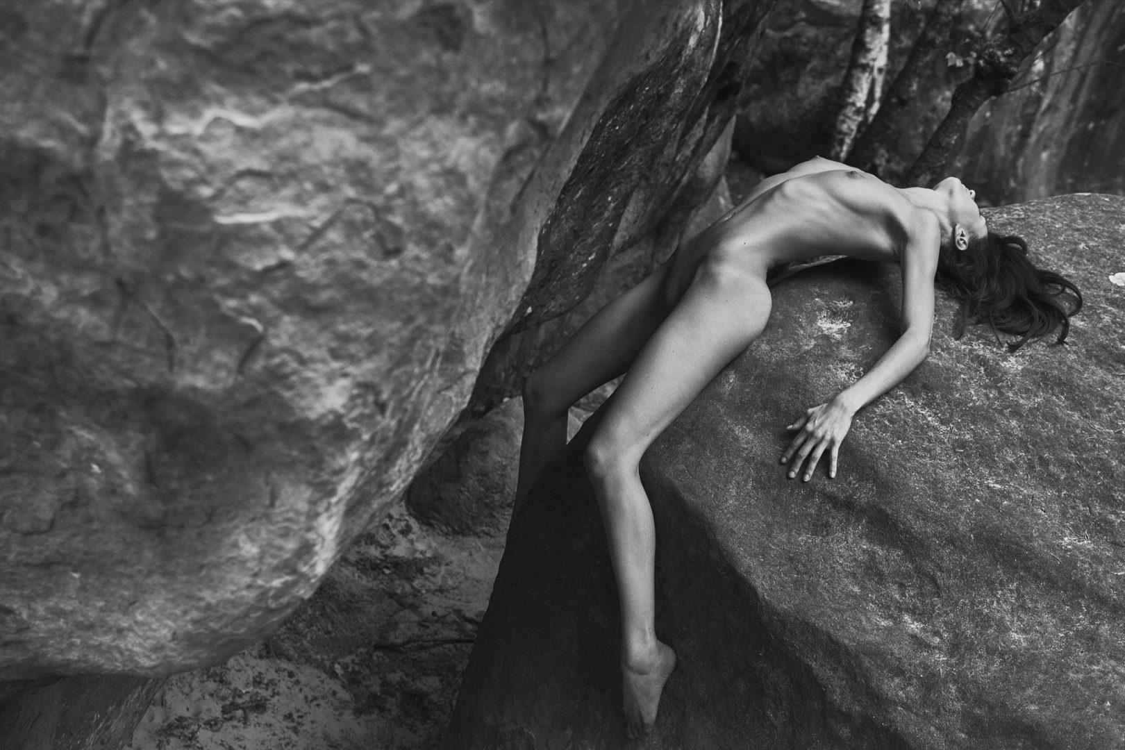 girl lying on rock