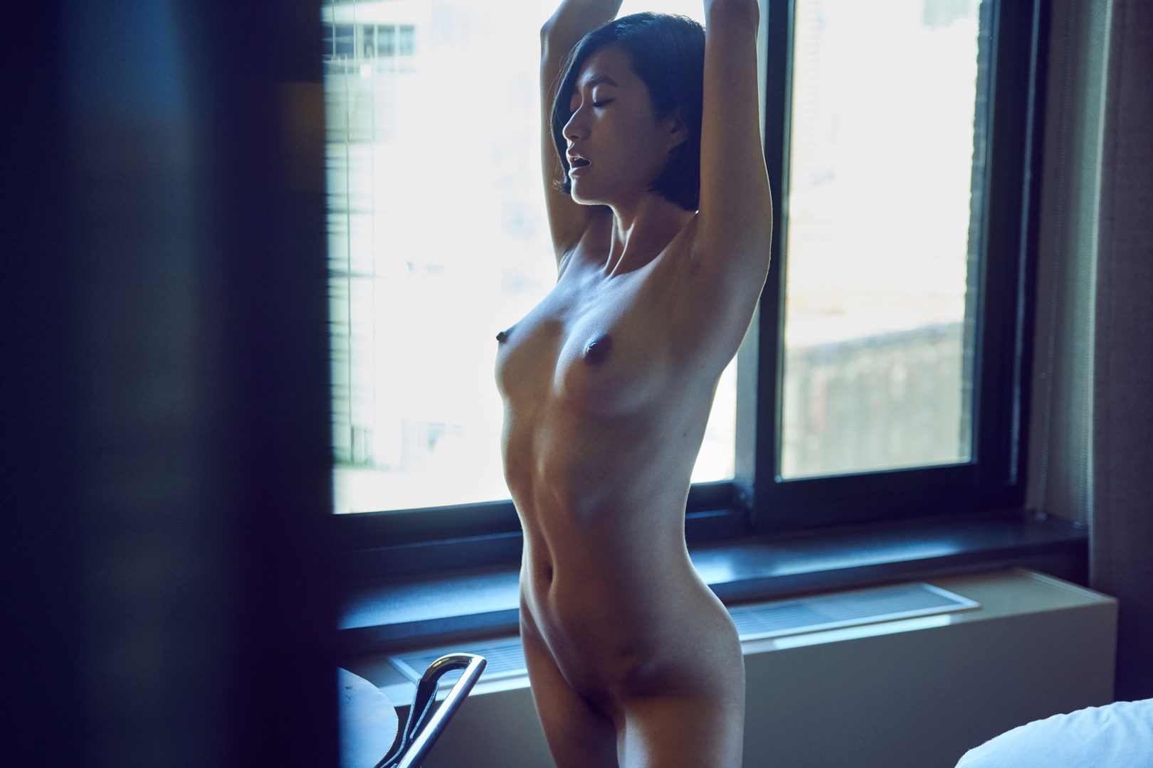 girl standing in hotel room
