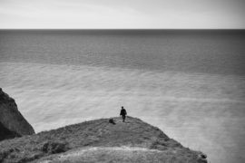 Thumbnail man on cliff